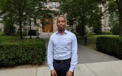 a photo of Title IX coordinator Kareem Peat taken with the Rose Hill campus in the background