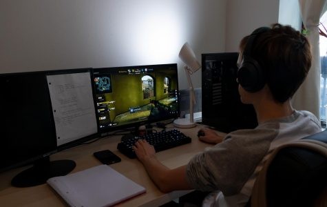 boy sitting at computer playing eSports