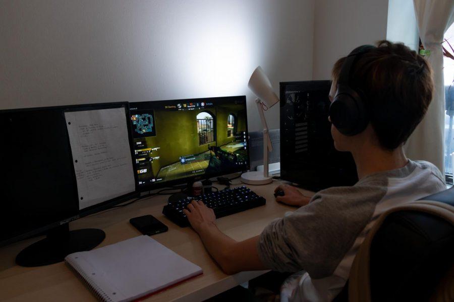 boy sitting at computer playing eSports