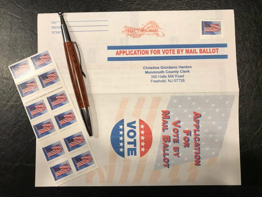 an application for mail-in voting with a pen and stamps