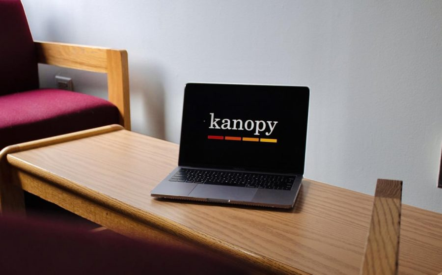 "a laptop sits on a dorm bench with the movie streaming site ""kanopy"" onscreen"