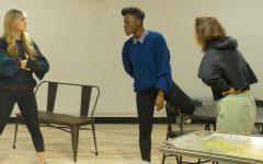 photo of three actors rehearsing