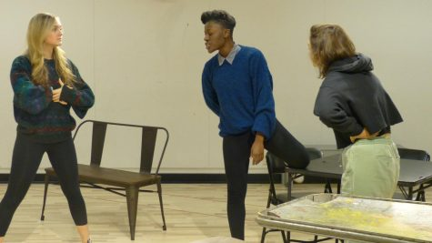 photo of three actors rehearsing