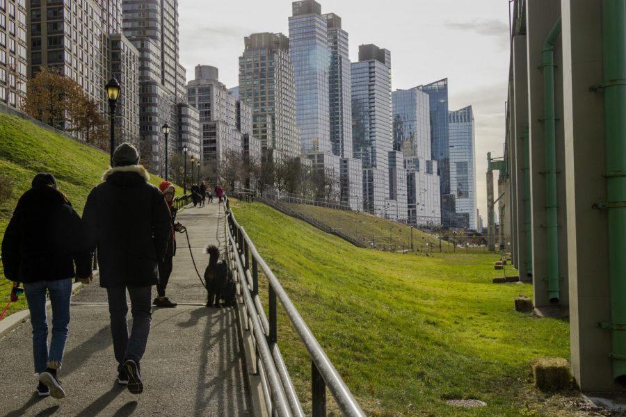 people walking in park by buildings