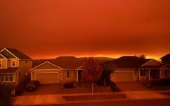 a red sky in oregon above suburban houses, which fuels concerns about climate change