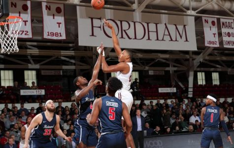 fordham basketball player making a layup on a basketball court