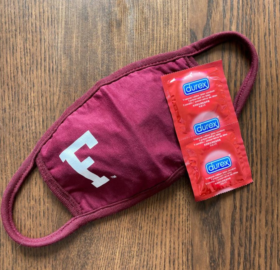 maroon mask with fordham F on it next to red condoms - sex in a pandemic