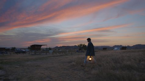 Woman walking at dusk with lamp