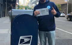USG vice president, student Robert Sundstrom, drops ballot in mailbox for 2020 election