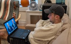 A young man watched Saturday Night Live on his laptop