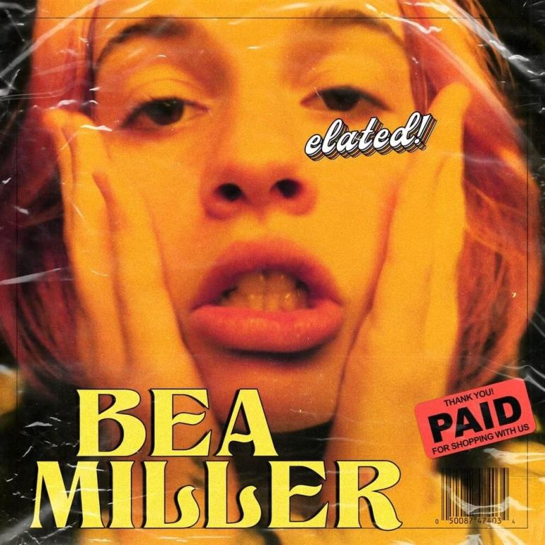 Album art for elated! with the face of Bea Miller and a paid sticker