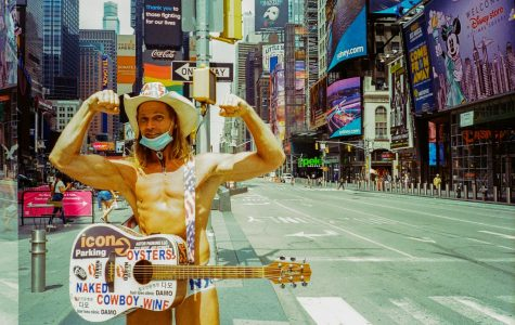 Naked Cowboy stands with guitar in front of empty Times Square