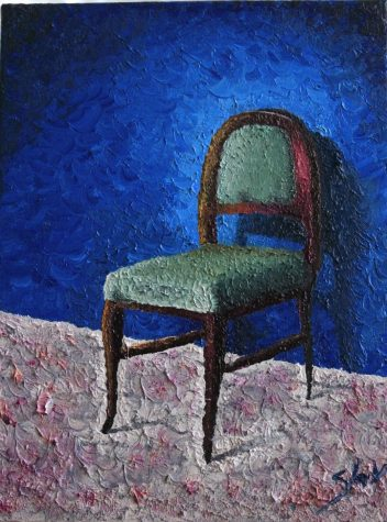 Green chair against blue background
