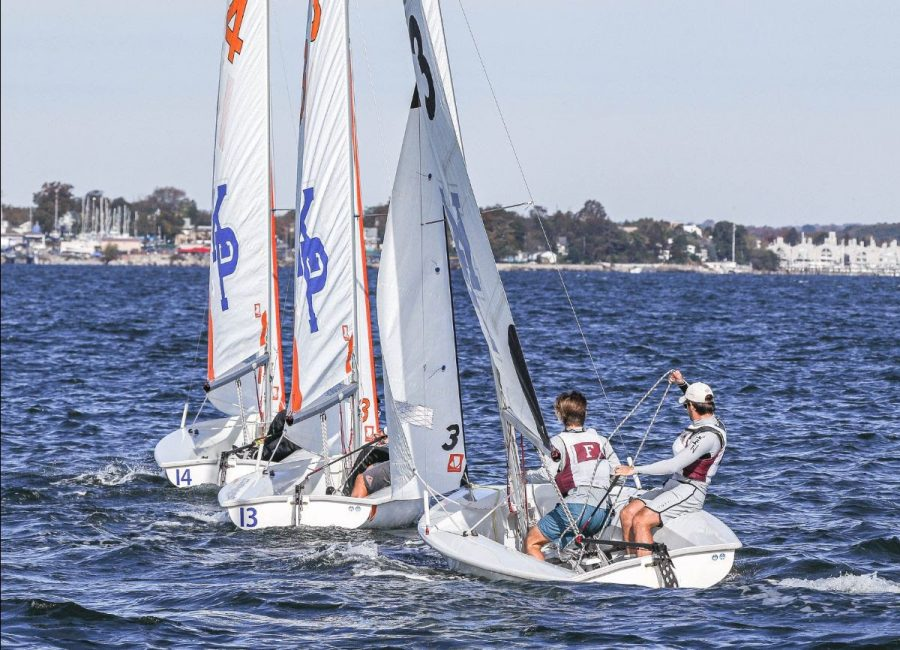 photo of sailboat on the water with two members of the intramural sailing team in it