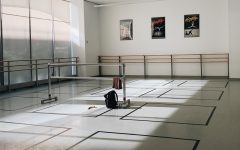 Empty dance studio with square marked on the floor in tape