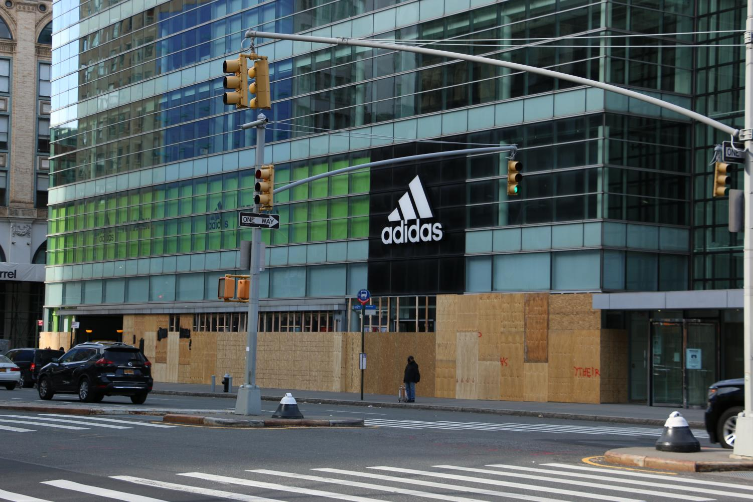 the Adidas store with its first floor windows entirely covered with boards