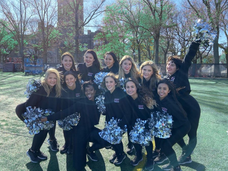 group+of+girls%2C+fordham%27s+dance+team%2C+on+a+football+field+with+black+uniforms+and+silver+pom-poms
