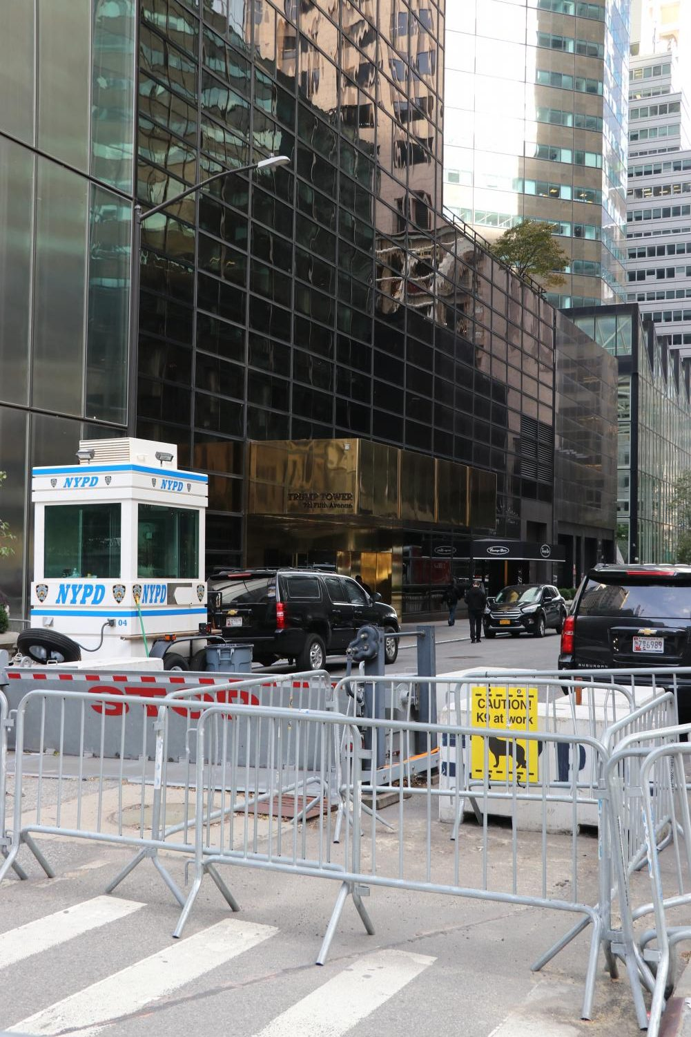 barriers and police cars in front of Trump Tower