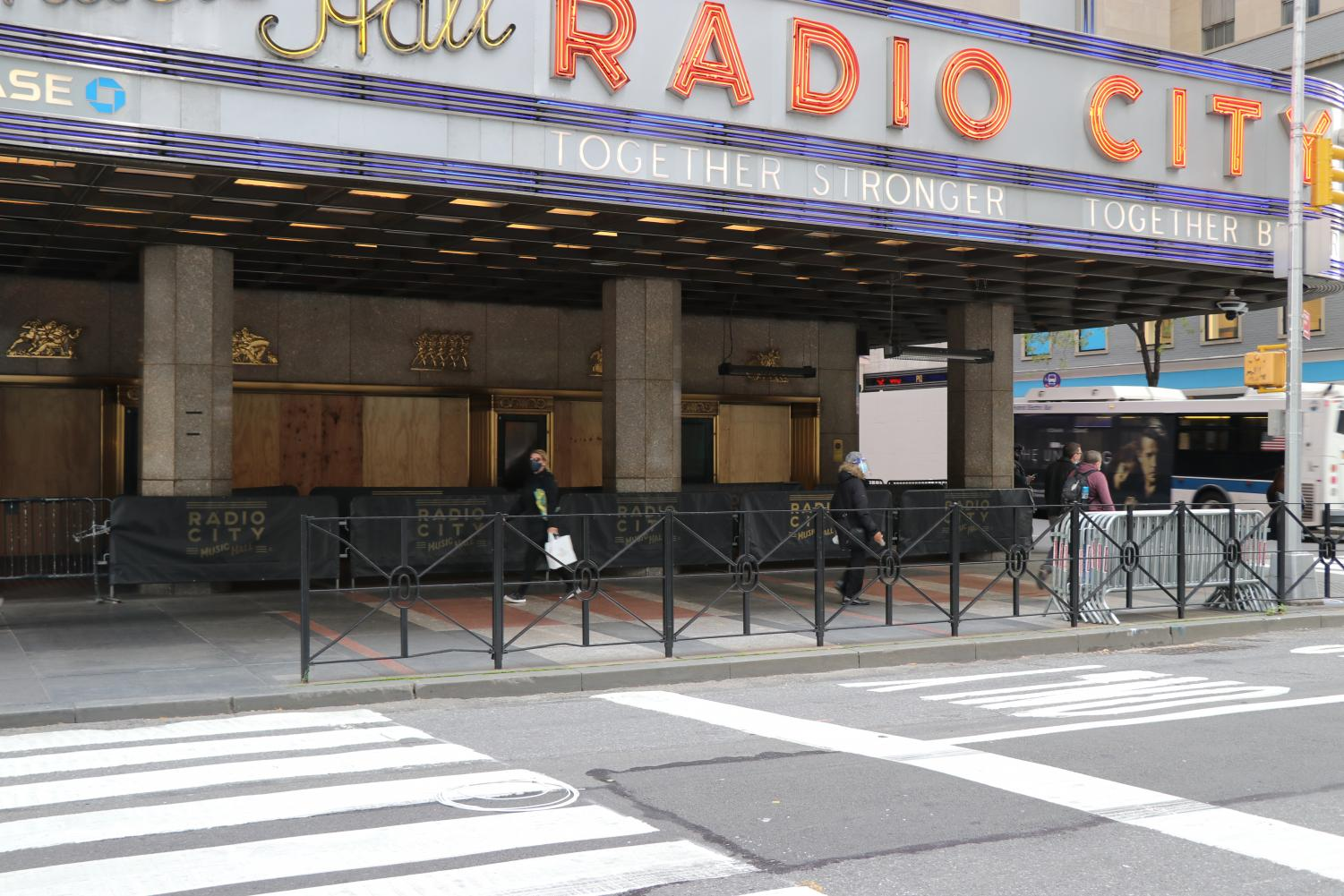 Radio City Music Hall seen from the street with boards on the windows