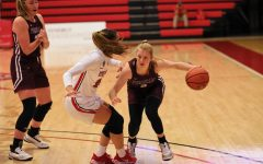 anna dewolfe and a stony brook player on the court
