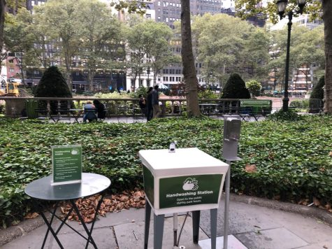 handwashing station in the middle of one of bryant park's stone-tiled spaces