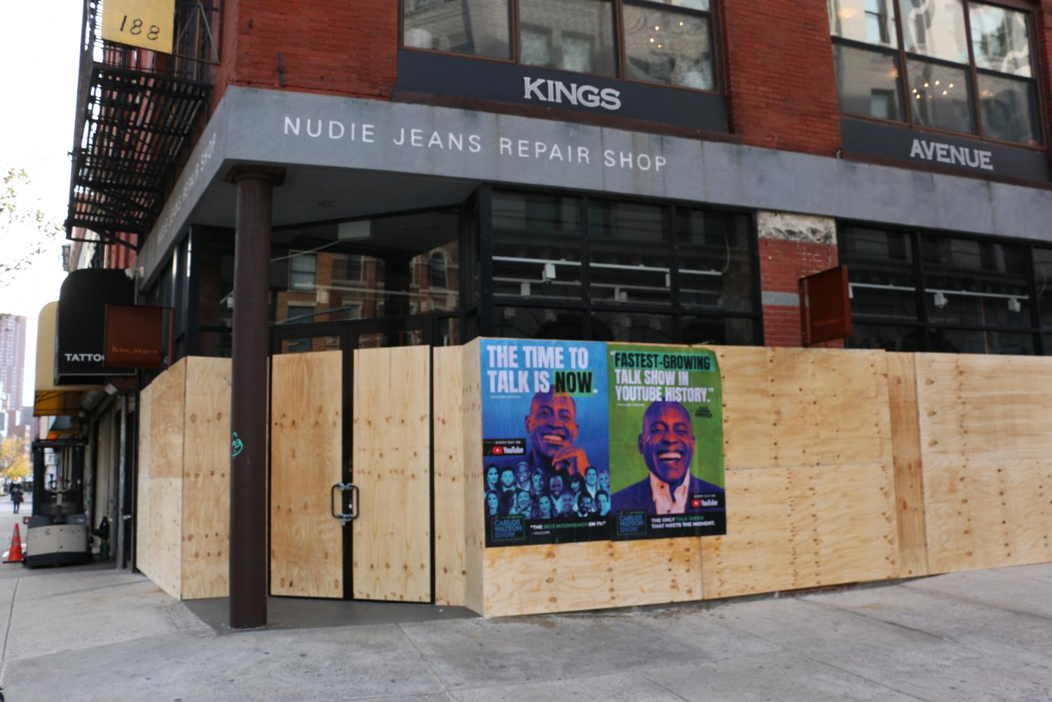 the Nudie Jeans Repair Shop with boards on the windows and posters advertising a Youtube show put up