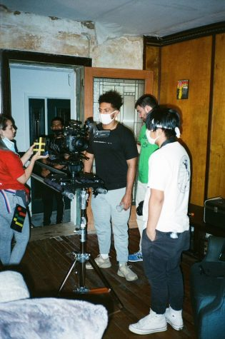 Tommy directs on set of his film