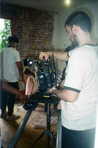 Enrique Caballero holds a camera on set of his new film
