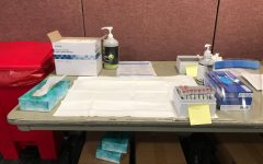 photo of samples at a covid testing center to accompany an article about rising positive cases among students