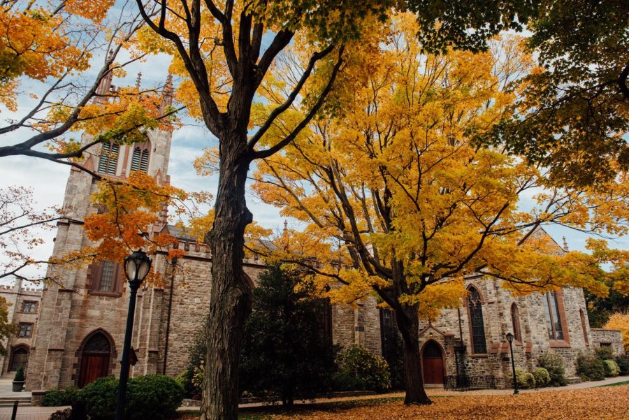 the university church viewed from the side with trees in fall colors in the foreground