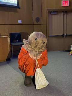 Someone squatting in a Trick 'r Treat Sam costume.