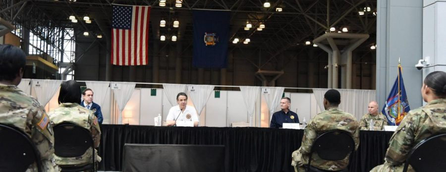 governor cuomo sitting at a table for a press conference
