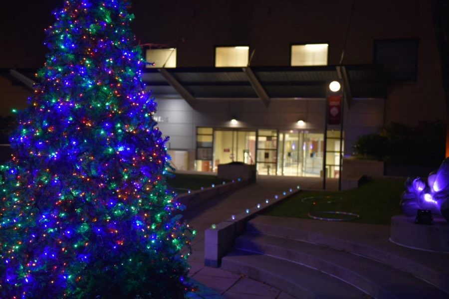 The Christmas tree with lights in front of the 140 West building