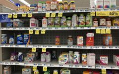 immune system boosting vitamins on the shelf of a pharmacy