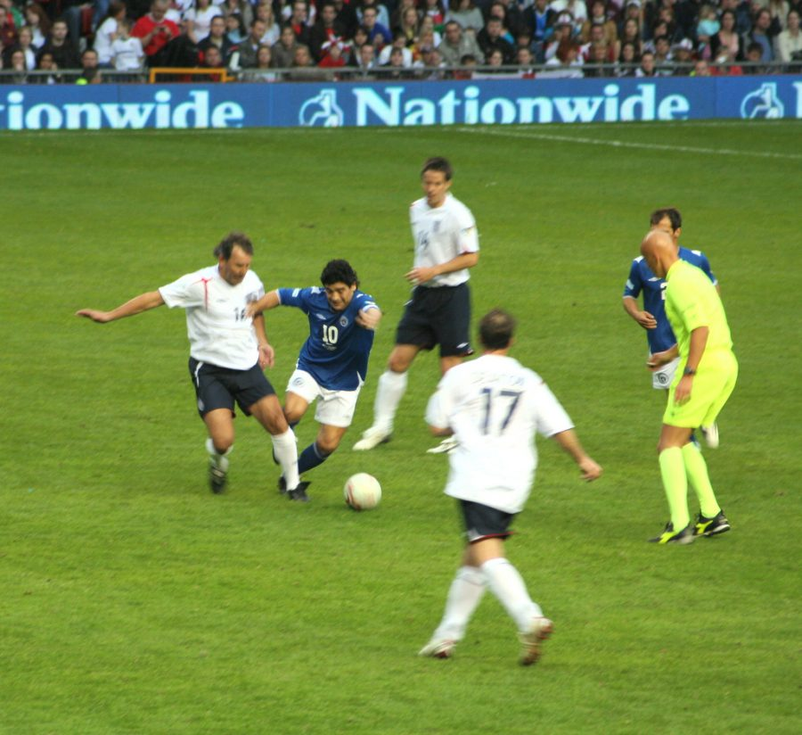 diego maradona and other soccer players on a field