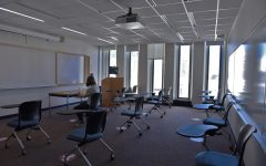 a student sits alone in a classroom
