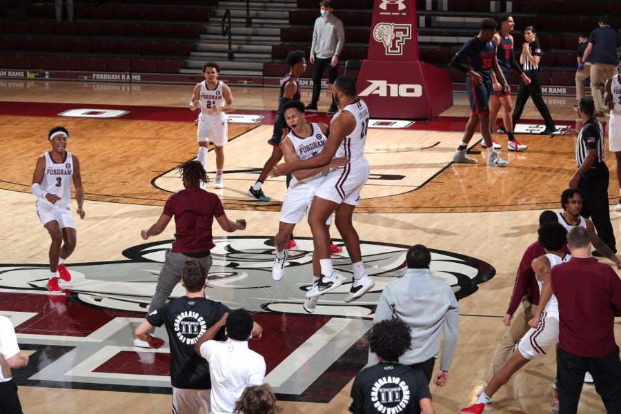 fordham+basketball+players+jump+and+hug+each+other+on+the+court+after+a+win+over+dayton
