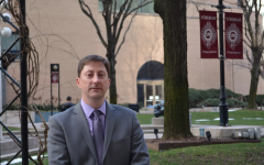 new dean of student services Keith Eldredge poses on the Outdoor Plaza