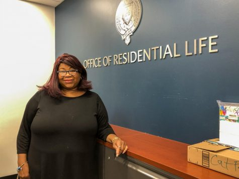 new dean of students Jenifer Campbell poses in the Office of Residential Life
