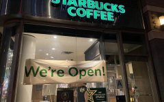 photo of a new york starbucks window with a sign saying