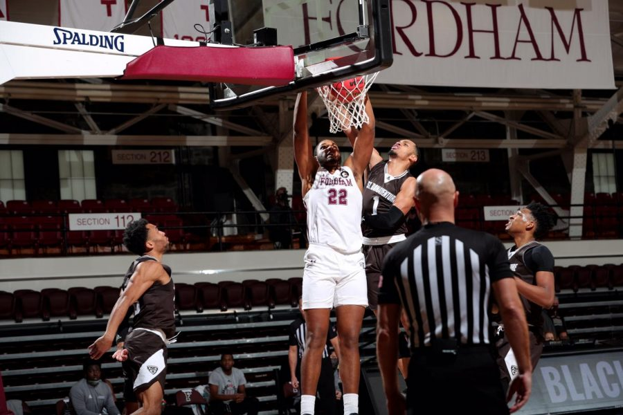 fordham player joel soriano makes a basket with three bonnies players and a ref surrounding him