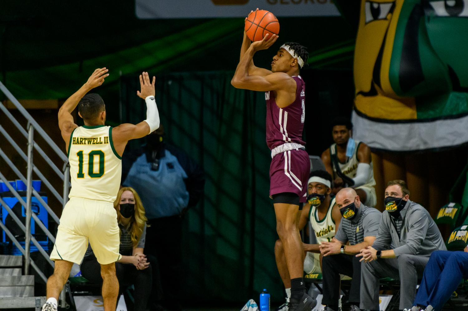 george mason player on the left and a fordham player making a basket on the right
