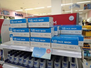 face masks on a shelf in a UK pharmacy