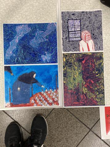 four of Antonio Garcia's artworks on display