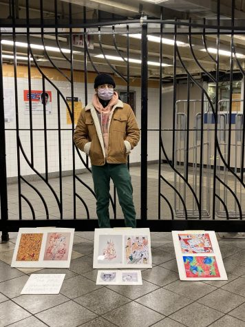 Antonio Garcia stands with his art display in a subway station