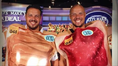 Bryce and Chad Davis pose wearing peanut butter and jelly sandwich costumes