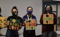 five student attendees of the Black History Month paining event hold up their artworks