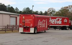 Coca Cola trucks parked in a lot