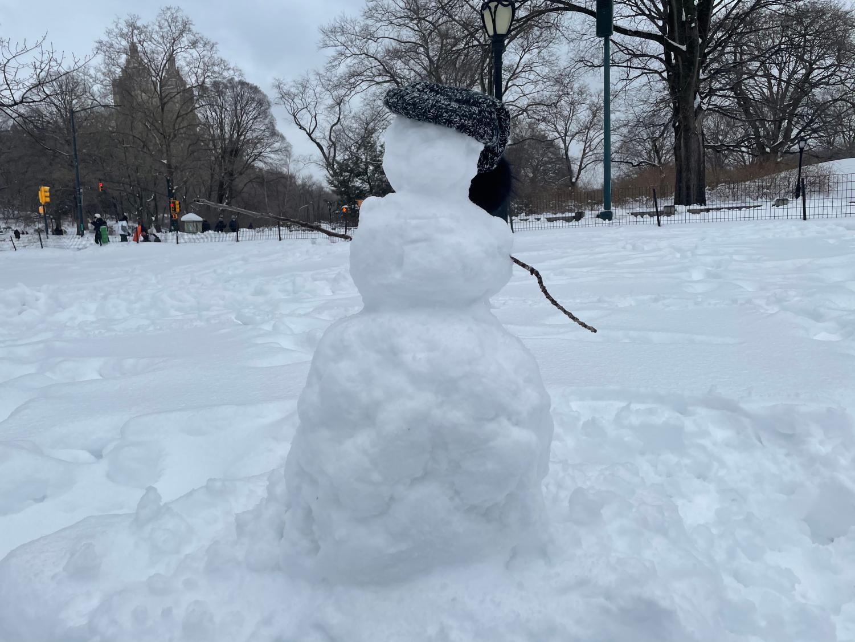 A snowman wearing a fur cap