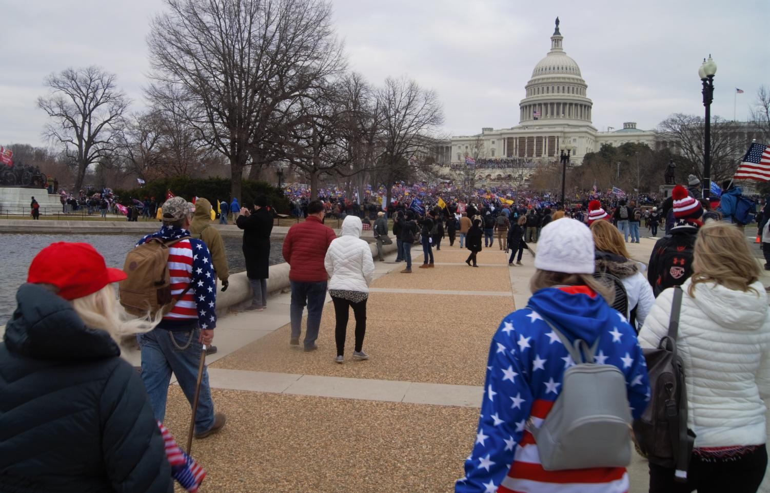 people stand outside the US Capitol building